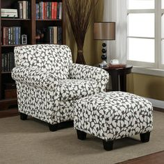 @Overstock.com - Portfolio Mira Gray Modern Floral Arm Chair and Ottoman - Comfort and beauty go hand-in-hand with this striking matching chair and ottoman set. The charcoal-gray and cream floral pattern is sublime, and the dark espresso finish on the square post legs brings additional richness to this lovely set.   http://www.overstock.com/Home-Garden/Portfolio-Mira-Gray-Modern-Floral-Arm-Chair-and-Ottoman/8025149/product.html?CID=214117 $360.89