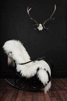 I'd add a giant glass hurricane and a limed oak candelabra to this antlers and fur mix.