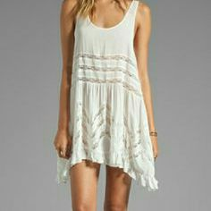 NWOT Free People Trapeze Slip Dress Brand new without  tags never worn or washed - Free People Voile Trapeze slip dress in White Combo with gray polka dots size L retail at $88 plus tax paid close to 98. Pullover styling, scoop neckline, sleeveless, sheer dotted with lace inset throughout, ruffled hem. Dress is unlined (SHEER), made with 100% rayon. Hand wash cold  No holes, no stains. Absolutely beautiful!! 1st and 2nd picture are stock photos Free People Intimates & Sleepwear Chemises…