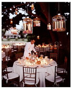 Loving the natural lighting, beautiful elegant look for an outside reception. Notice the roses in the candle holders? Gorgeous.