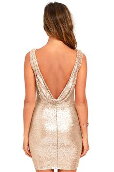 Your time to shine starts the moment you slip into the Shine Time Rose Gold Sequin Dress! Matte sequins in a pale, rose gold hue travel across a rounded neckline and darted, sleeveless bodice. Sexy cowl back drapes above a bodycon skirt. Hidden side zipper with clasp.