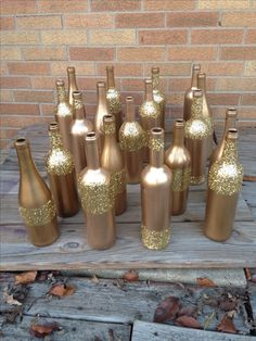More gold glitter wine bottles for centerpieces! Modge podge does the trick!
