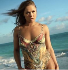 Sports Illustrated Swimsuit 2016 features three separate cover models: Hailey Clauson, MMA star Ronda Rousey in body paint, and Ashley Graham. Ronda Rousey Body, Ronda Jean Rousey, Swimsuits 2016, Swimwear, Ronda Rousy, Sports Illustrated Swimsuit 2016, Women With Beautiful Legs, Rowdy Ronda, Sexy Body