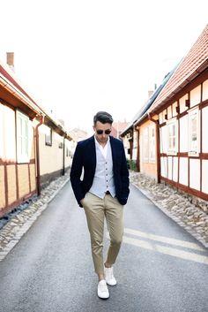 Navy blazer + striped vest + khaki pants + white sneakers