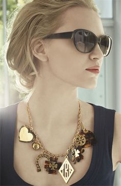 Pretty sunglasses, gold necklace.