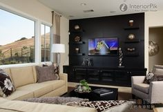 Effect picture of classic black living room TV background wall decoration--Add floating shelves in a contrasting color for some pop.