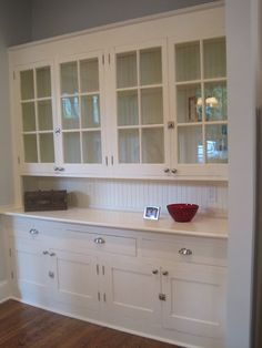 I love the idea of a built in butler's pantry taking up the whole wall! This would provide so much storage. Having all drawers instead of cabinets on the bottom portion would also be very functional. I love the beadboard backing!
