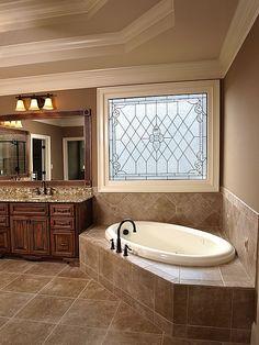 corner soaker tub abuts vanity...not sure how shower would work