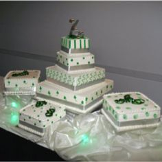 "Modern square green tiered wedding cake - great for an Irish / St. Patricks Day Wedding.  We had Clovers / Shamrocks on one of the tiers, as our wedding reception was the day after St. Patty's Day.  The green glowing lights are just a few extra ""glow ice cubes) that we used as wedding favors."