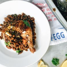 Za'atar-rubbed chicken is cooked atop a bed of lentils and sprinkled with…