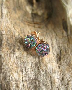 Gorgeous, peacock druzy quartz stones are bezel set in NEW rose gold vermeil ear posts with backs. Natural, druzy stones are coated with titanium