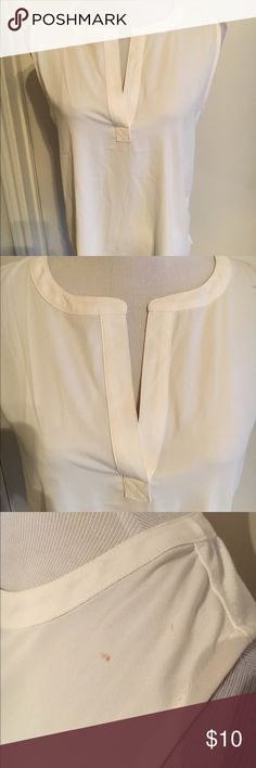 Loft Off White Split Neck Mixed Media Shell Top Gorgeous cream Shell top from Loft. Goes with everything and has only been worn a handful of times. It no longer fits me or else I would definitely keep it! Features a split neck and rounded shirttail hemline, which is super flattering. Jersey stretch on the back and flowy polyester on the front. There is a small stain on one shoulder (see photos) that showed up after getting my hair dyed :(  It might come out with a spot remover, but I haven't…