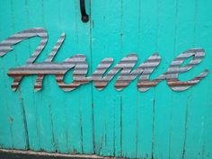 HOME sign in Kansas Barn Tin Junk Rusty wall by Studio11Online
