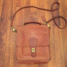 Vintage Leather Coach bag Vintage leather brown coach bag. Authentic with gold spin clasp. Coach Bags Crossbody Bags
