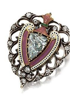 AQUAMARINE, ENAMEL AND DIAMOND BROOCH, CARLO & ARTHUR GIULIANO, EARLY 20TH CENTURY . Of stylized heart shape, set in the center with an aquamarine of modified shield shape within borders of pink, green, white and black enamel, the openwork frame set with small old-mine diamonds, mounted in gold and silver