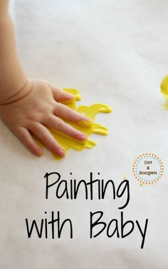 Exploring paint with a baby for the first time.