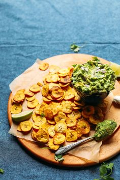 Crispy, baked plantain chips with garlicky guacamole! A satisfying alternative to corn chips, ready in just 30 minutes, with 7 wholesome ingredients!