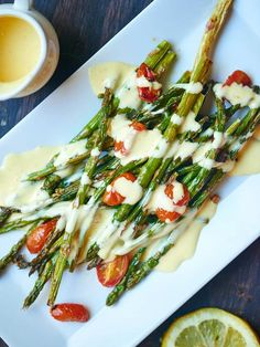 This roasted asparagus and tomato with lemon garlic hollandaise is a truly simple & elegant dish.