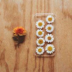 Glue daisies to an clear iPhone case.