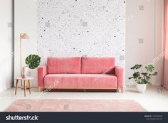 Real photo of a pink, velvet sofa, plant, coffee table with pot and cups on a lastrico wall a living room interior living room interior royalty free stock images stock photo Pink Velvet Sofa, Pink Couch, Living Room Interior, Home Interior Design, Rosa Couch, Feature Wall Design, Decoration Chic, Living Room Designs, Furniture