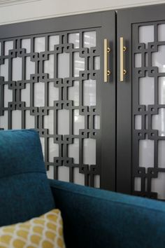 Screen a bookcase with cabinet doors. Designer Minhnuyet Hardy had a mod pattern laser cut into wood panels and then backed the panels with opaque acrylic. This allows the members of the family to have all manner of items on the shelves and close at hand, while visually quieting the room.