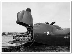 A Convair R3Y Tradewind loading a tractor in 1954. WRG #: 0022348
