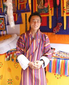 "This man is wearing a ""gho"" - traditional Bhutanese clothing."