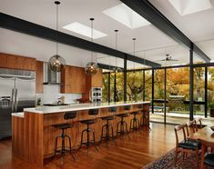 Creekside home of glass and steel infused with warmth in Austin