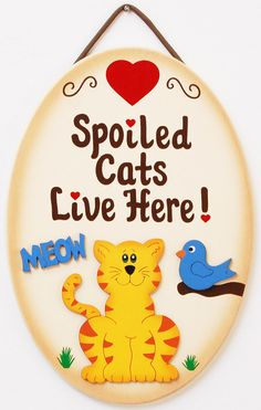 6 3/4 x 9 3/4 Spoiled Cats live here signs are made from wood and painted with a very high quality cream color exterior paint. Edges of the spoiled cat