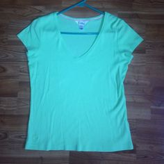 Lilly Pulitzer Med vneck lime green/ yellow top Size medium , great condition, all cotton. Third picture shows the color best. If you have any questions feel free to ask! Lilly Pulitzer Tops Tees - Short Sleeve