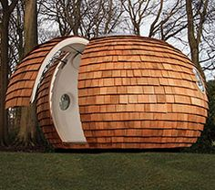 Pod. This type of design isnt something that I like as being put into a small space that has no obvious exit isnt something I look into however using wood against the trees and grass is linking materials together and looking at taking being in your space a different way.