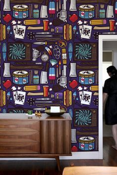 I love the wallpaper as it is all illustration. I kinda want it for the kitchen but really don't like the bloody teeth and all the guns. I know it's supposed to be for a boy's room but people better rethink that idea. :P