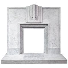 Art Deco Style Carrara Marble Fireplace | From a unique collection of antique and modern fireplaces and mantels at https://www.1stdibs.com/furniture/building-garden/fireplaces-mantels/