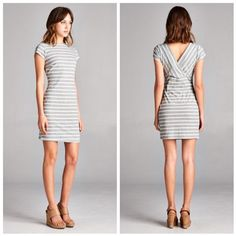 "Aubrey🔸 Short Sleeve Mini Dress Short sleeve mini dress with V crossed back. Horizontal grey and white stripes and high round neckline. Material is 95% polyester and 5% spandex. Measurements laying flat (Bust, Hip, Length) - Small: 15"", 16"", 33.5""; Medium: 16"", 17.5"", 34.5""; Large: 17"", 18.5"", 35.5"". Vega Boutique Dresses"
