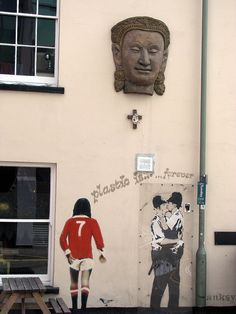 Banksy graffiti in Brighton. Known for its oriental architecture and large gay community.@