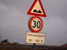 Fartsdempere (as funny as that sounds because Fart in Norwegian means fast) is a speed bump in Norwegian.  The red circled 30 is the speed in Kilometers.  Oh and they drive on the same side of the road as American's do.  That is always a question I get asked.