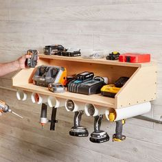 Drill Dock drill dock garage organization storage DIY Drill Dock drill dock garage organization storage DIY Garage Shop Workbench Plans Top 50 best garage workshop ideas 30 ~ IRMA PVC pipe holsters project All in one work bench and table saw/ etc Garage Tool Storage, Workshop Storage, Garage Tools, Garage Organization, Diy Storage, Organization Ideas, Storage Ideas, Kitchen Storage, Storage Cabinets