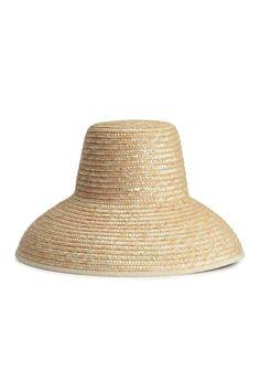 Chapeau de paille: Chapeau en paille tressée avec bord en textile à la base. Largeur de la calotte 14,5 cm.