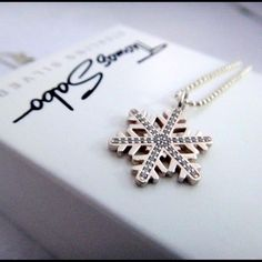 """Thomas Sabo 925 Silver Crystal Snowflake Pendant The snowflake charm was bought from Thomas Sabo in its U.K. Stores. The charm is embellished with Swarovski crystals, perfect for winter time wear. This listing only includes the snowflake pendant. The ball chain necklace (925 Sterling silver, costs extra $20, 16"""" long with 2"""" extension) can also be purchased as an add-on option. In that case, please make an offer with the total price of both the pendant and the necklace. Both are brand new…"""