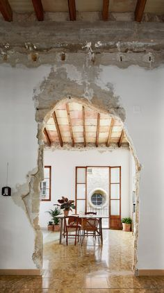 Dining Room, Chair, and Table  Photo 11 of 13 in A Salvaged Apartment on Mallorca Leaves its Roots Exposed