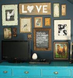 gallery wall with vintage art, prints, and family photos- eclectic and rustic with hints of gold