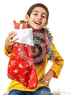 Stock Image: Happy boy showing christmas gift beautiful smiling kid red box sock isolated white background. Happy Boy, Vector Illustrations, Christmas Gifts, Stock Photos, Boys, Red, Image, Beautiful, Xmas Presents