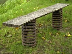 Exclusive bench from piece of wood and old car springs