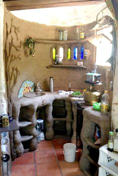 I love the tiny stove in this space, perfect for heating water Natural Building, Green Building, Building A House, Cob House Interior, Apothecary Decor, Earthy Home, Earth Bag Homes, Earthship Home, Mud House