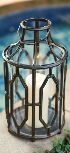 Cathedral-style window glass in our Beverly Lantern illuminates with a glow of divine reverence. For entertaining or intimate get-togethers, our cast aluminum lantern creates an ambiance of tranquility from glimmering candlelight.
