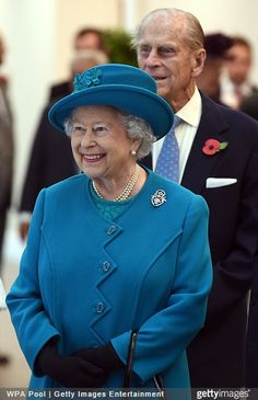 Queen Elizabeth, October 30, 2014 in Rachel Trevor Morgan | Royal Hats.....Posted on October 30, 2014 by HatQueen.....  Queen Elizabeth and the Duke of Edinburgh were in Wolverhampton today where they openned the new Jaguar Land Rover Engine Manufacturing Centre and paid a visit to International Security Printers to view their work on specialist postage stamps.