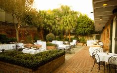 """eat """"out"""" at broussard's in new orleans Commercial Design, Commercial Interiors, Planter Boxes, Planters, Courtyard Restaurant, Best Of New Orleans, Courtyard Wedding, Wedding Set Up, Outdoor Spaces"""