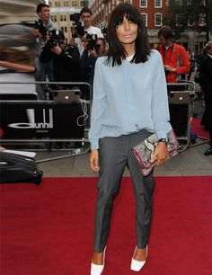 Claudia Winkleman wearing a Peter Pan-collared chiffon blouse, grey trousers and white Jil Sander patent leather pumps to the fashion GQ Men of the Year Awards