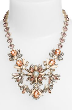 Spice up any outfit with a bold statement necklace! The glittering, multihued crystals and opaque marquise jewels add so much drama.