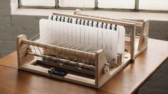 An artist is developing a desktop loom to make fabric production hands on.